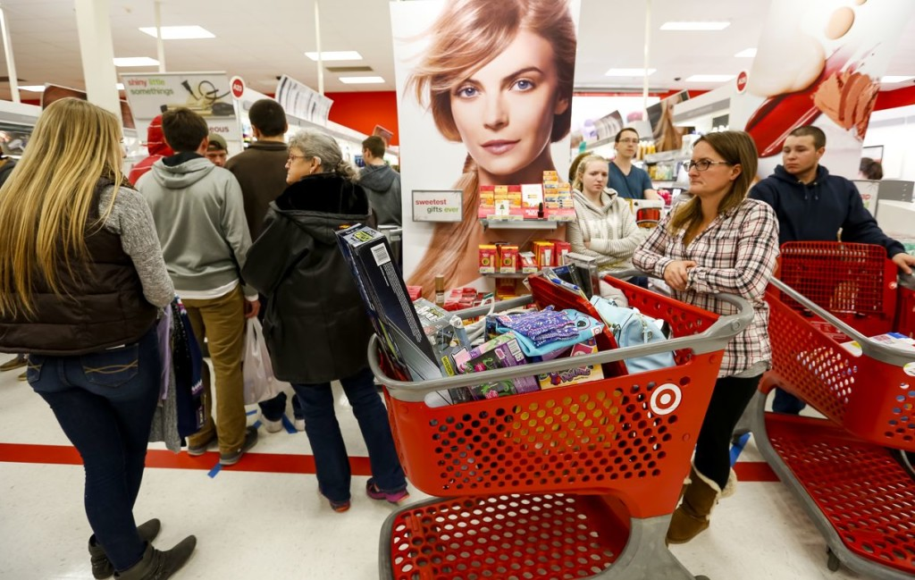 A long, serpentine checkout line weaves through the aisles at Target Friday morning.  Ben McCanna/Staff Photographer