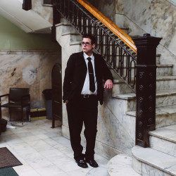 Landlord Adam Rice, standing in the lobby of one of 657 Congress Street, is being groomed to take over his family's Apartment Mart business. The 62-year-old Portland company has 300 units in the area.