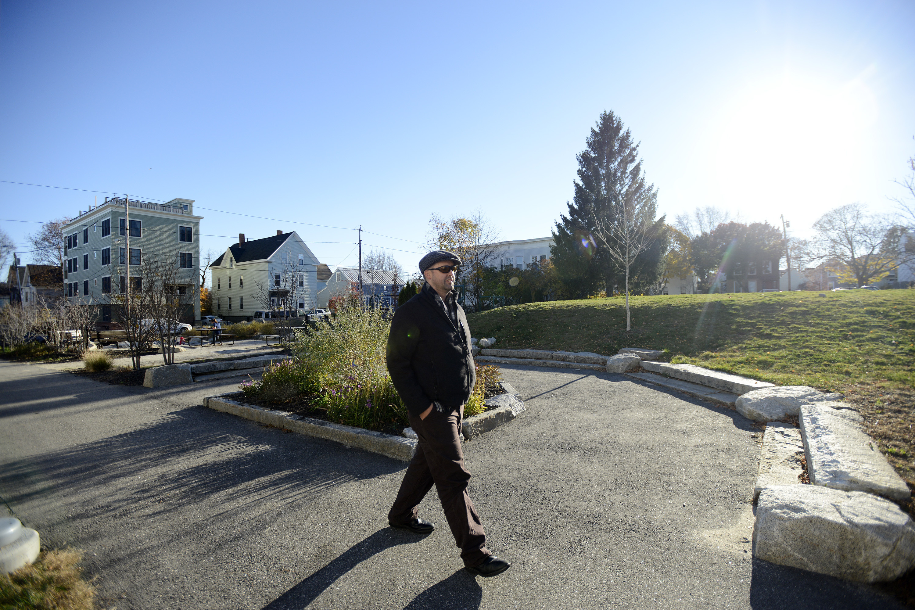 Kevin Donoghue walks in his Munjoy Hill neighborhood near Marada Adams Park