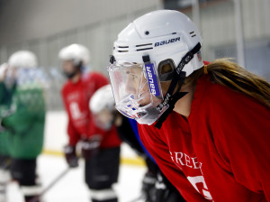 Greely hockey player Danita Storey listens to her coach during a practice at Casco Bay Arena.  Derek Davis/Staff Photographer