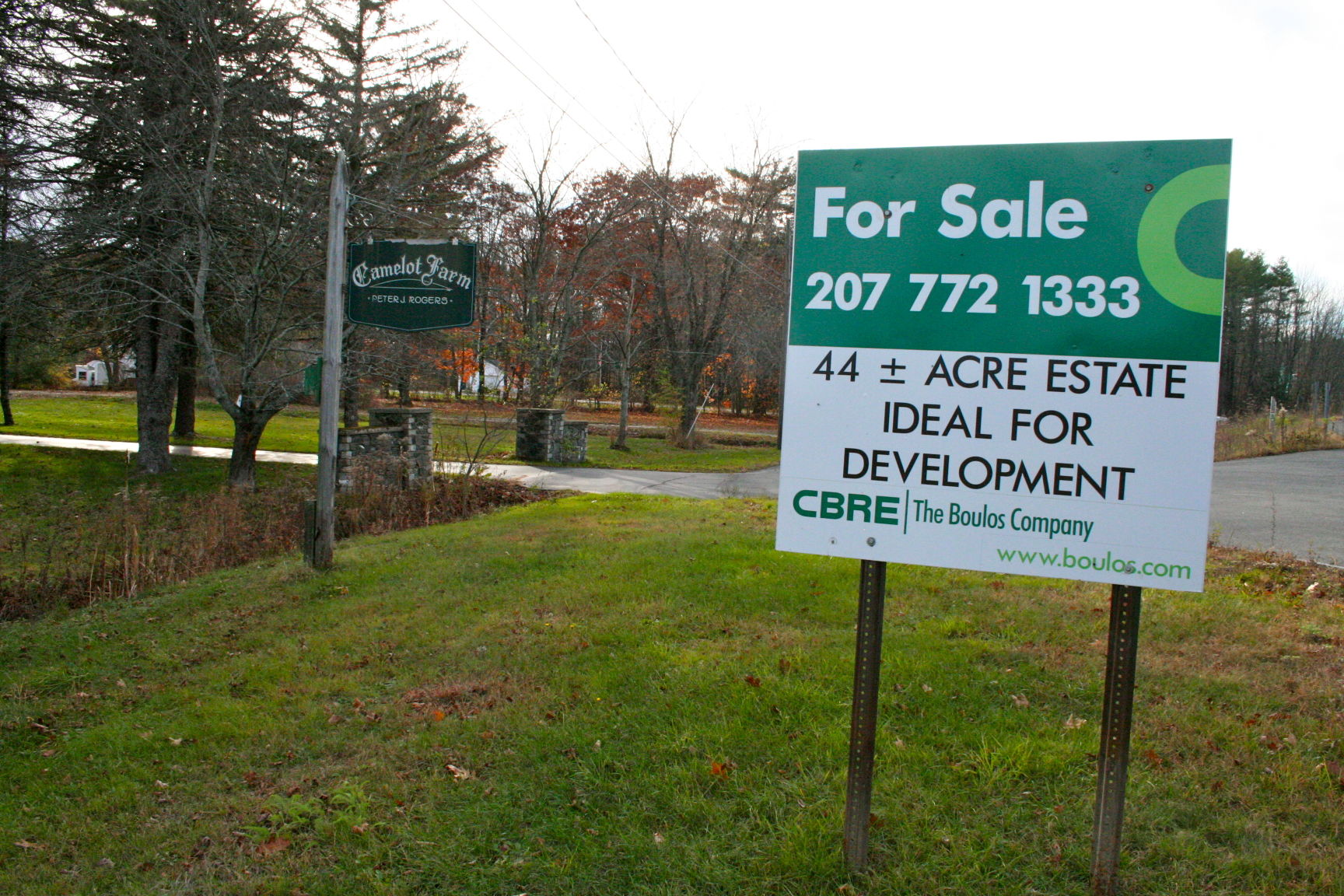 A for sale sign stands in front of camelot farm in portland this week the historic farm just on the other side of the westbrook border will most likely