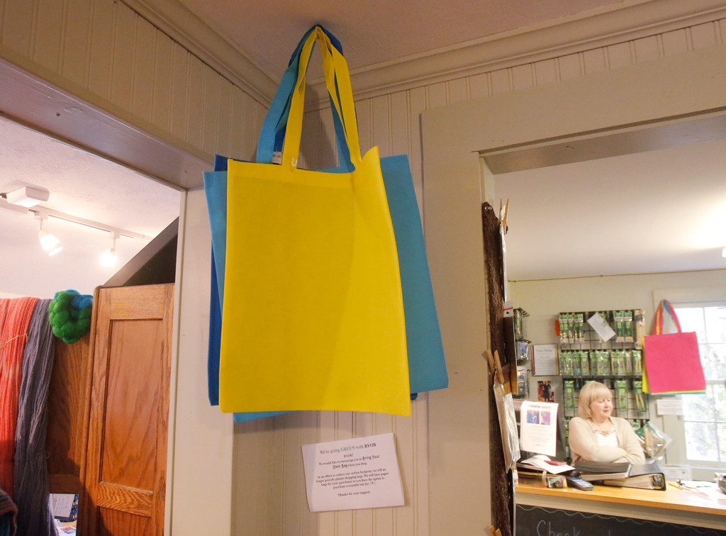 Reusable bags are offered for sale at The Yarn Sellar in York. York voters on Tuesday approved a ban on plastic bags, the first outright ban of single use bags in Maine. The Yarn Sellar stopped using plastic bags earlier this year.