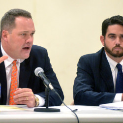 Gregg Frame, left, attorney for Waterville Senior High School principal Don Reiter, right, responds on Tuesday to allegations that his client engaged in inappropriate conduct with a student in August.  The exchange occurred during a public hearing at George J. Mitchell School in Waterville.