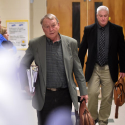 Eric Haley, superintendent of Waterville schools, and Assistant Superintendent Peter Thibotot, back, leave the final school board executive session of the night Wednesday at George J. Mitchell School in Waterville.