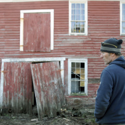 Brett Trefethen surveys a barn in Vienna earlier this month that he plans to raze to reclaim the boards.