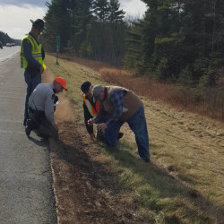 State police, investigators from the State Fire Marshal's Office and rangers from the Maine Forst Service investigate the scene of one of the six intentionally set fires along Interstate 95 Friday morning.