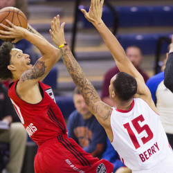Raptors 905 guard Jay Harris goes up for a shot against Red Claws guard Davion Berry during D-League action at the Portland Expo on Sunday. Carl D. Walsh/Staff Photographer