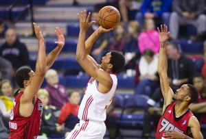 Maine Red Claws forward Malcolm Miller goes up for a shot between Raptors 905 a forward Walter Pitchford (L) and Melvin Johnson (R) during D-League action at the Portland Expo on Sunday. Carl D. Walsh/Staff Photographer