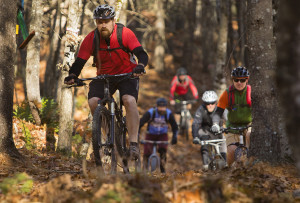 Hidden Valley Nature Center volunteer Shawn Day leads fat bike riders, bikes with fat tires, along the trails in Jefferson on Sunday, Nov. 8. Carl D. Walsh/Staff Photographer