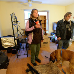 Jane Footer looks over her new apartment on the day she moved in. To the right is her friend Jeff Laymon who helped her move in.