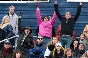 From left, Maryann Pendleton, an English teacher at Portland High School, Laureen Mcinnis and Mark Lade stand and put their arms up in celebration after a touchdown by George Chaison-Lapine puts Portland ahead 17-0 in the second quarter.