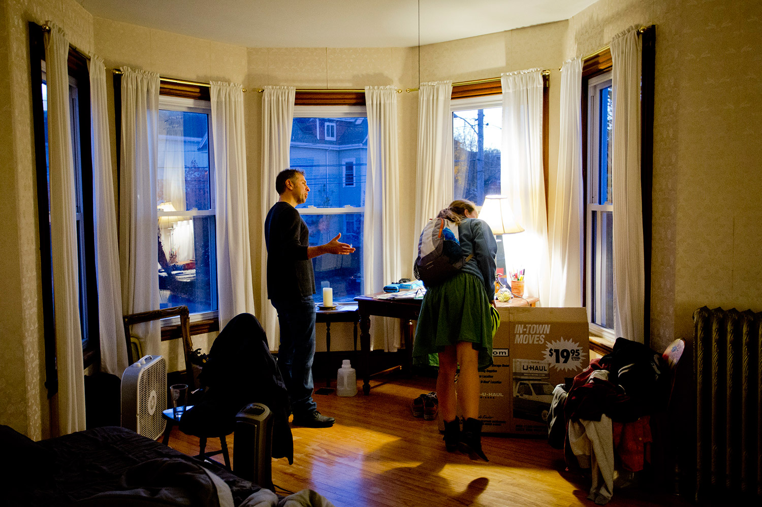 Pete Risano shows Maddie Purcell, 25, of Portland, a two-bedroom apartment for rent