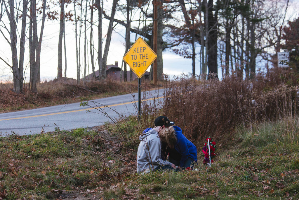 Kara Buzynski holds her brother, Nate Buzynski, after they placed flowers on a memorial for Angel Greene, who was killed in a car accident on Turkey Lane in Buxton on Thursday.