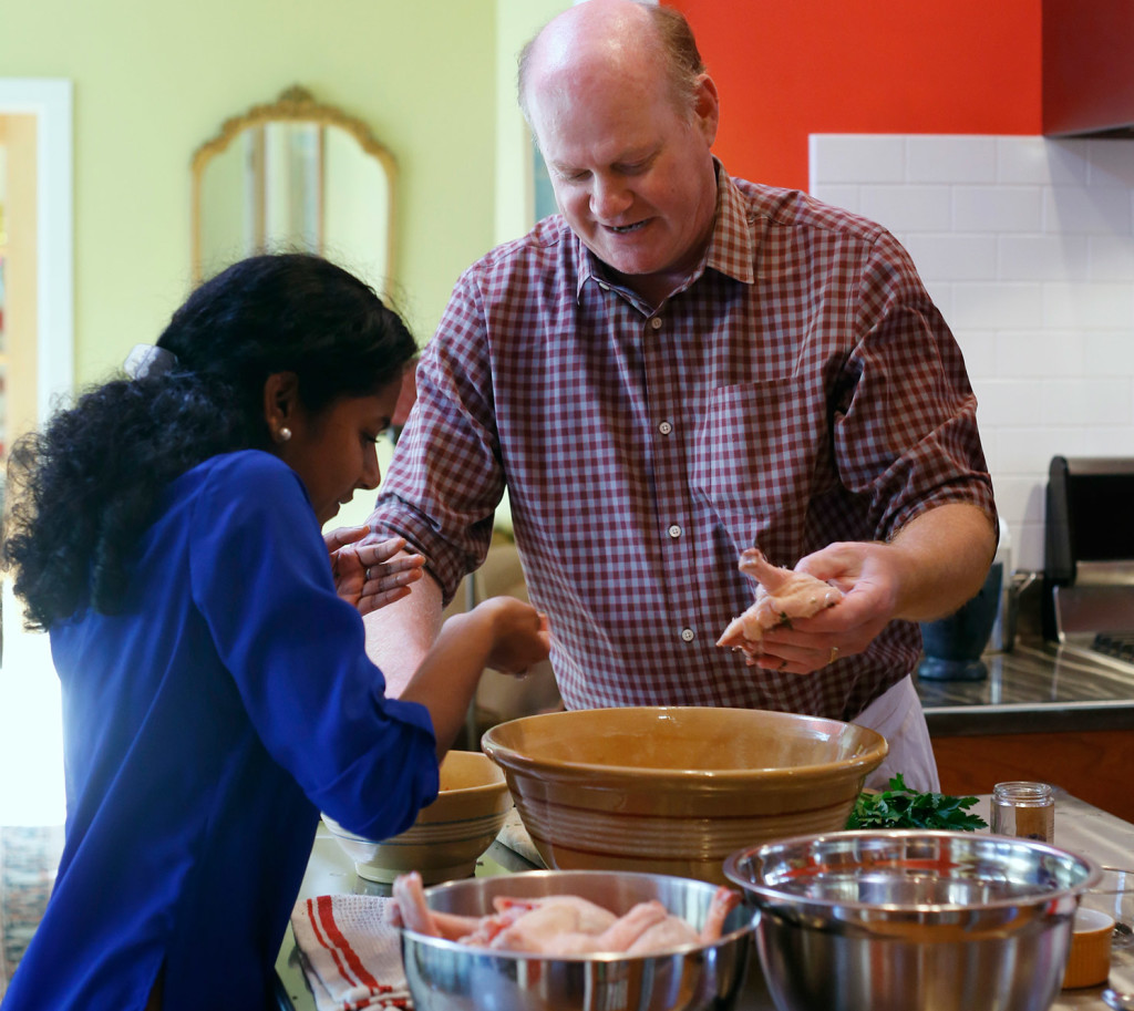 Michael Sanders teaches his daughter Lily to make duck confit.