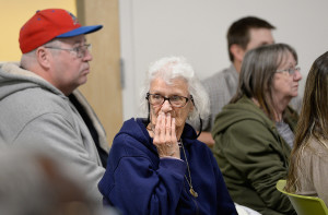 Lyndall Mink, 82, who lives at Franklin Towers, listens to residents speak during the meeting held Thursday by the Portland Housing Authority. People older than 60 comprise the largest portion of residents in the public housing complex.