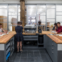 Reclaimed wood from an old warehouse in Skowhegan was used to create these countertops in a barista training center in New York City.