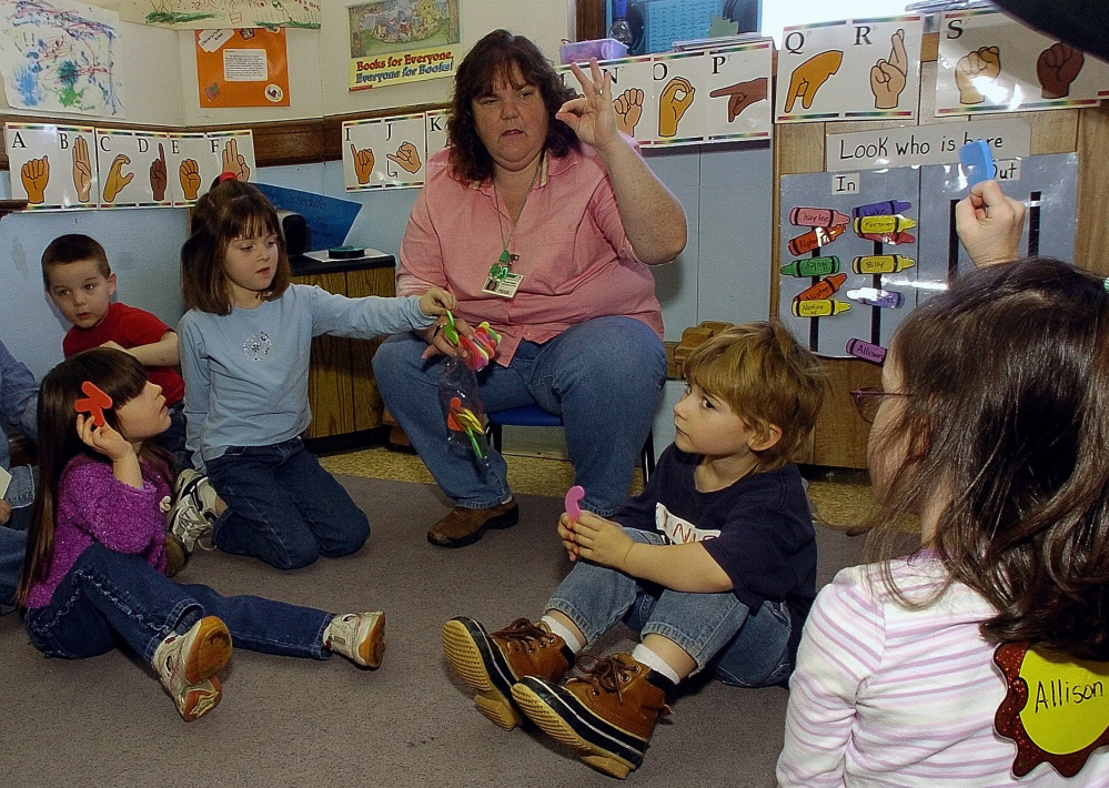 Teacher Theresa Wight instructs preschool students on sign language at Fairfield Primary School on Thursday. David Leaming/Morning Sentinel