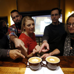 """The judges point to their favorites during a baristas competition  at Coffee By Design in Portland. From left are: Michael Acosta, a barista at J. Rene Coffee Roasters in West Hartford, Conn.;  Jesus Gomez, the head barista at J. Rene Coffee Roasters; Jana Barnello, anchor of """"Good Day Maine;"""" Anestes Fotiades, founder of Portland Food Map; and Kathleen Pierce, a journalist and food blogger. Derek Davis/Staff Photographer"""