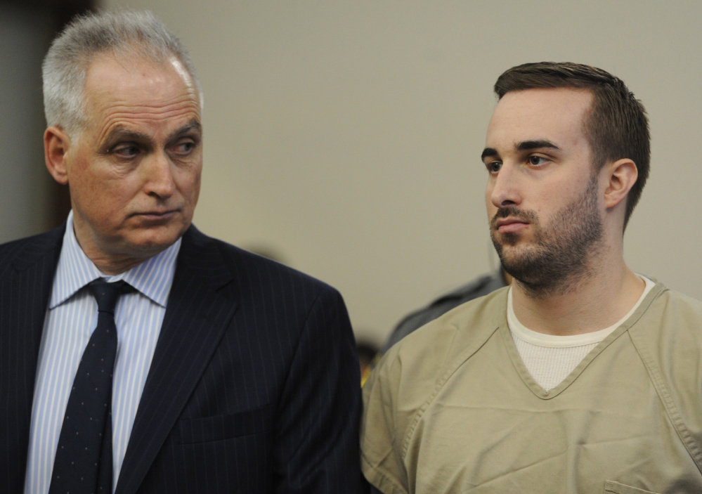 Kyle Navin, right, seen with his attorney, Eugene Riccio, is arraigned in Bridgeport Superior Court, in Bridgeport, Conn., on Tuesday. His parents went missing in August. Their remains were found Oct. 29 outside a vacant house in neighboring Weston.