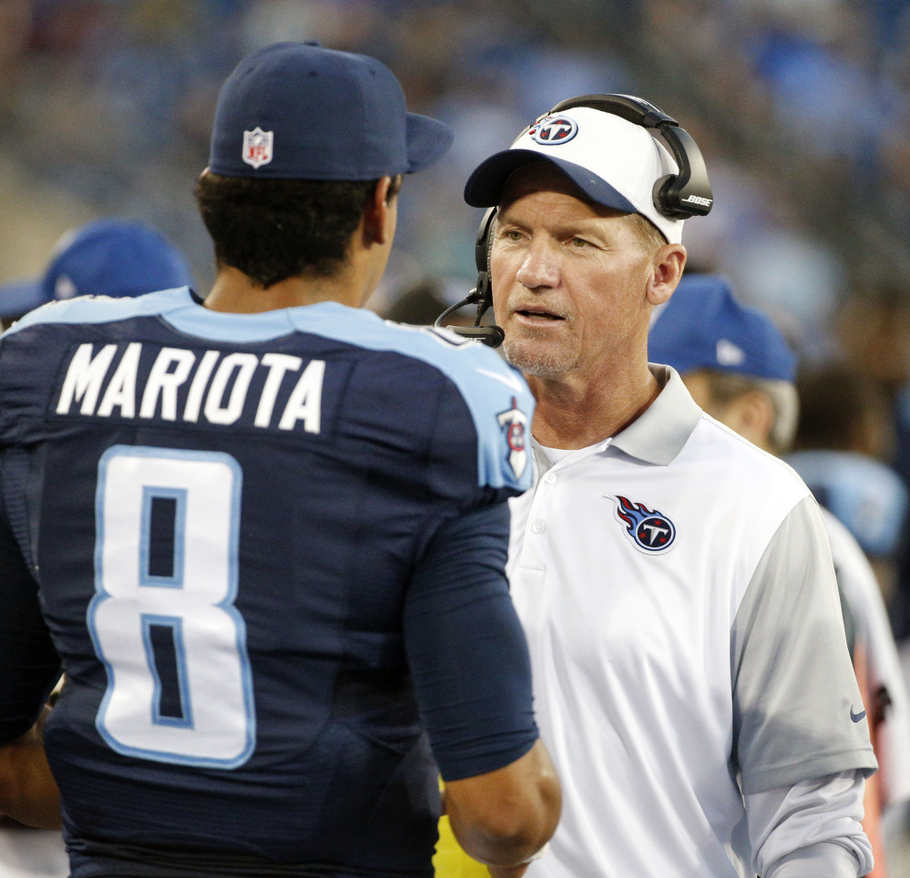 Tennessee Coach Ken Whisenhunt, seen talking with quarterback Marcus Mariota, was fired by the team after logging a dismal 3-20 record in less than two years on the job, including a 1-6 start this year. Mike Mularkey, a former head coach in Buffalo and Jacksonville, was named interim coach.
