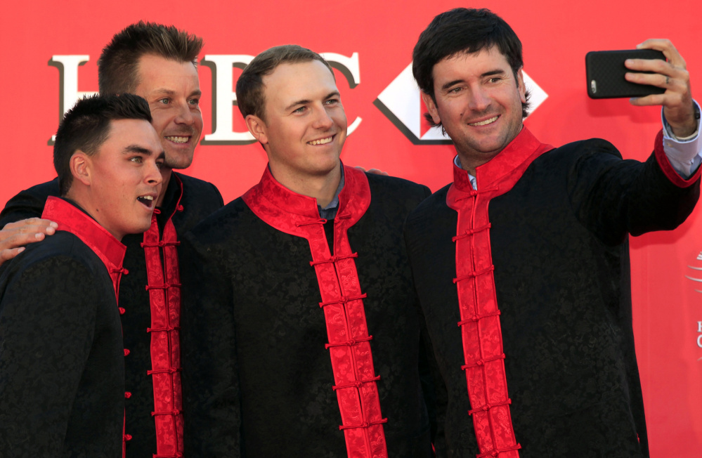 From left to right, golf players Rickie Fowler, Henrik Stenson,  Jordan Spieth and Bubba Watson, take a selfie during the HSBC Champions golf tournament photocall in Shanghai, China Tuesday, Nov. 3, 2015. (AP Photo)