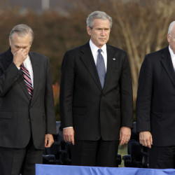 Secretary of Defense Donald Rumsfeld, left, pauses as President George W. Bush and Vice President Dick Cheney participate in Rumsfeld's farewell ceremony at the Pentagon in 2006.