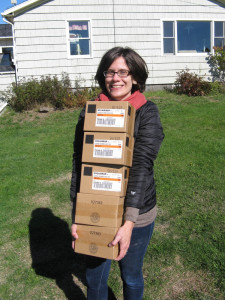 Suzanne MacDonald, community energy director at the Island Institute, delivers boxes of LED lightbulbs to a home on Matinicus Island.