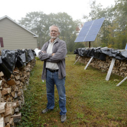 Dan Burr lives off the grid in Damariscotta. He uses wood to help heat his home and solar panels for electricity.