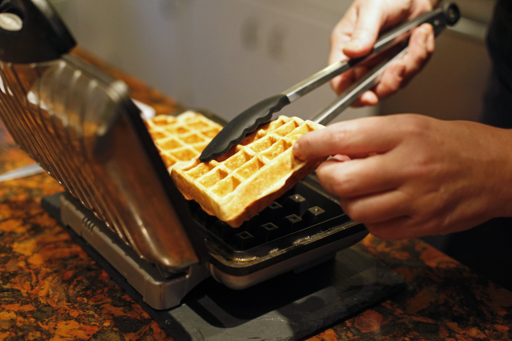 Christine Burns Rudalevige makes banana waffles. Photos by Jill Brady/Staff Photographer
