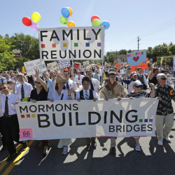 Members of the Mormons Building Bridges march during the Utah Gay Pride Parade in Salt Lake City in 2013, but overall the church has been slow in accepting homosexuality.