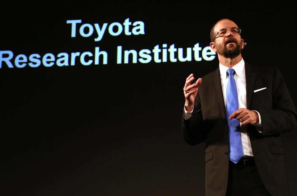 Robotics expert Gill Pratt, hired to lead Toyota's artificial intelligence push, talks about goals for safer cars at a news conference in Tokyo on Friday.