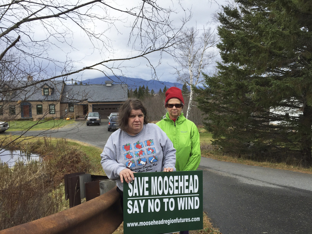 "Janet Chasse, left, a Greenville resident who is fighting wind power efforts, stands with Linda Koski, who lives next to Moosehead Lake. ""If (wind developers) get the idea that enough people don't want them here, maybe they won't come,"" Chasse said."