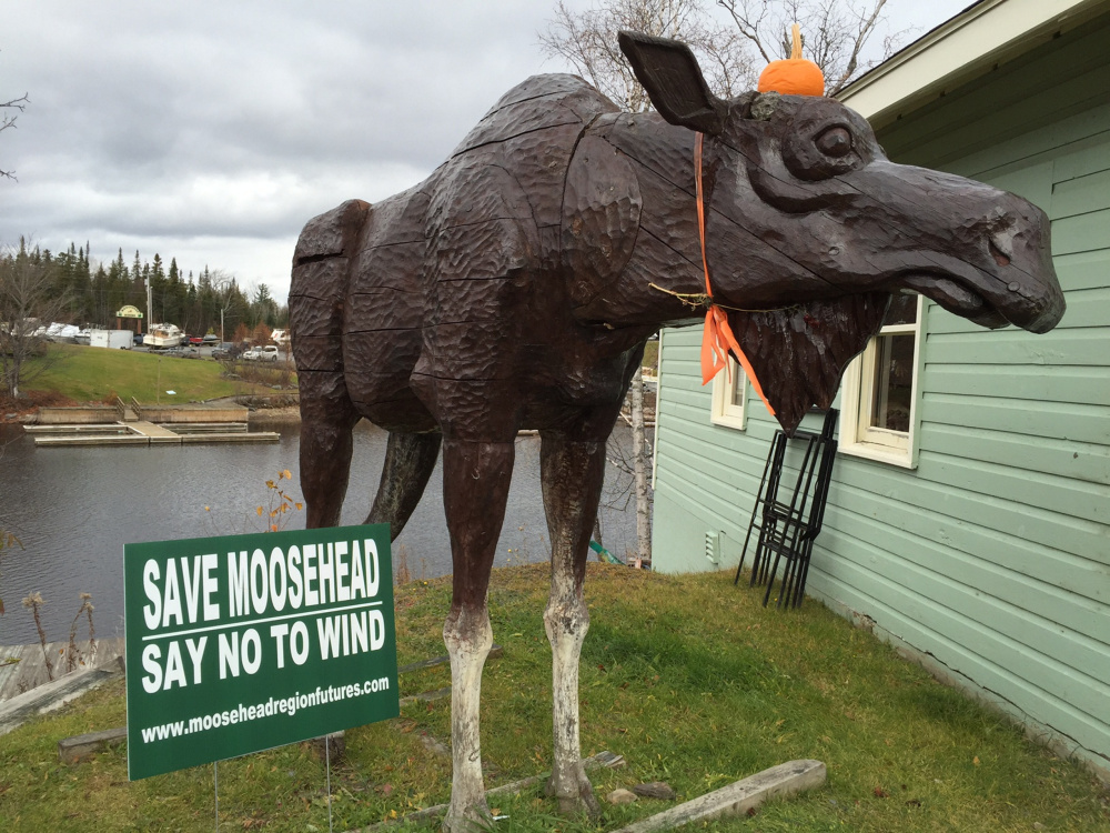 Anti-wind signs, such as this one in Rockwood, are common sights around Moosehead Lake. SunEdison had planned to meet with local residents in September to brief them about its plans. That meeting was canceled and isn't likely to be rescheduled until next summer, when seasonal residents return.