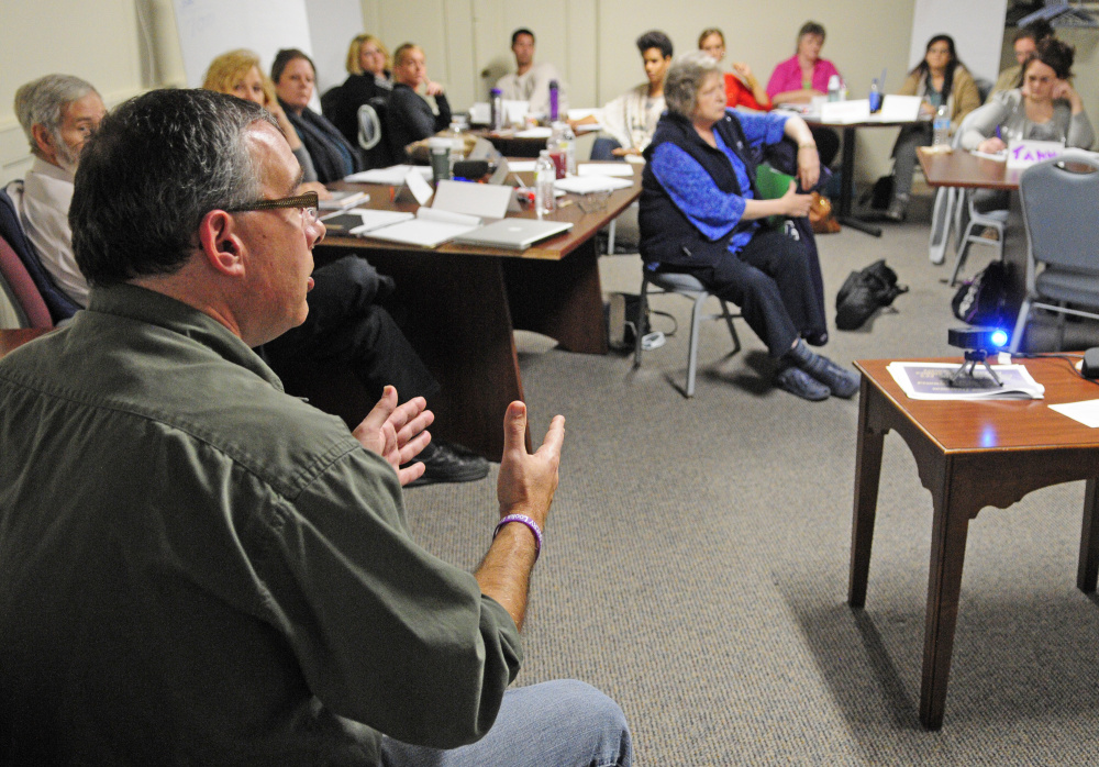 """Darren Ripley, of the Maine Alliance for Addiction Recovery, talks during training for people volunteering as """"angels"""" on Friday  at the Olde Federal Building in Augusta."""