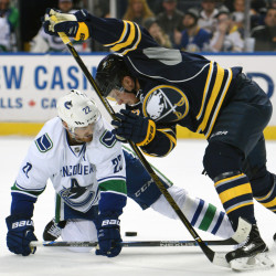 Canucks left wing Daniel Sedin, left, battles for the puck with Sabres rookie center Jack Eichel, right, during the second period Saturday in Buffalo. Eichel had two assists in the Sabres' 3-2 win.
