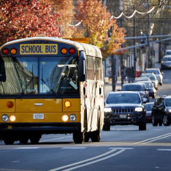 A school bus travels along Congress Street in Portland on Monday. The nation's top highway safety official says the agency will pursue a policy to require seat belts on school buses.
