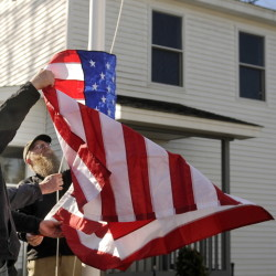Residents of the Bread of Life Ministries Veterans Shelter in Augusta raise the flag there last Veterans Day. Shelters are essential, but to put an end to homelessness, policymakers must go much deeper.