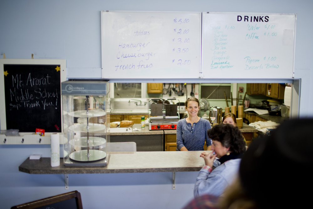 Jenn Legnini greets customers in the cafe at the Winter Farmers' Market in Topsham.