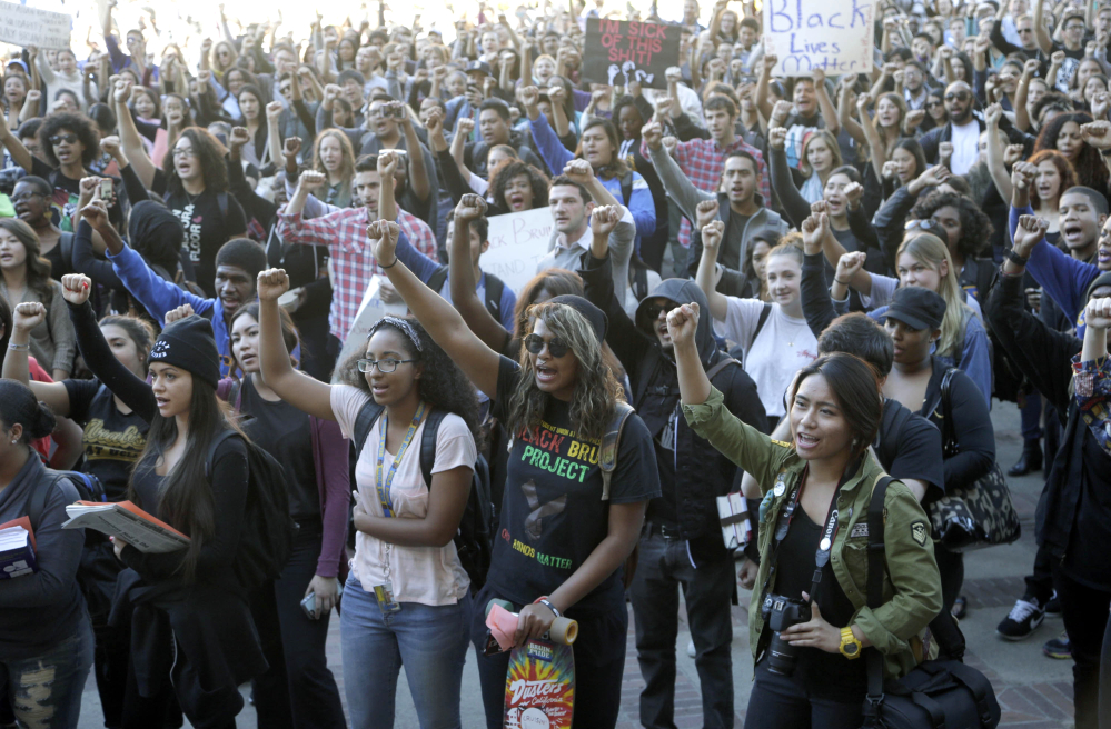 University of California Los Angeles students stage a protest in a show of solidarity with protesters at the University of Missouri on Thursday in Los Angeles. Thousands of students across the U.S. took part in demonstrations at university campuses.
