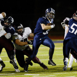 Portland's Joe Esposito runs up the middle against Windham's defense in Friday night's Class A North championship game.