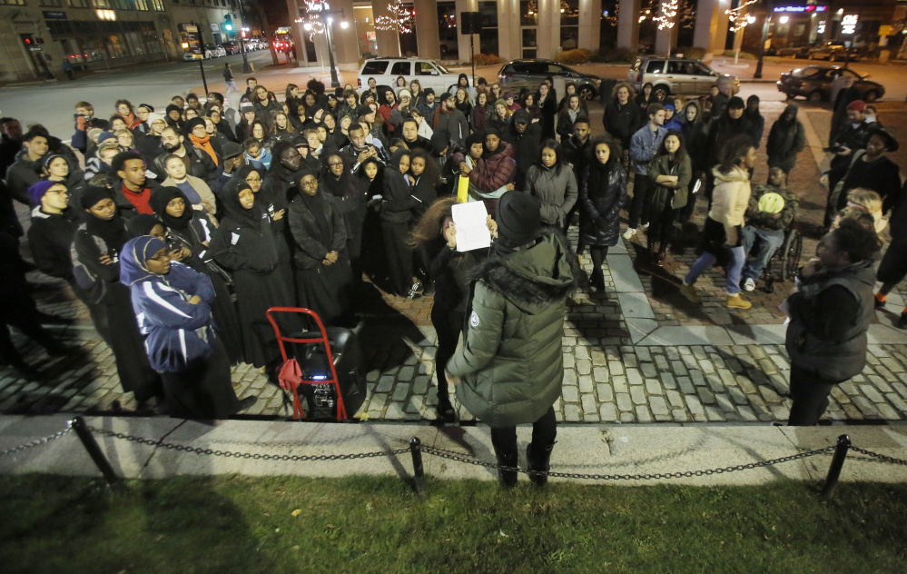 Hamdi Hassan, center, a sophomore at the University of Southern Maine, speaks during a rally held in Monument Square on Friday night to show support for students at the University of Missouri who are protesting racial incidents at their school. About 150 people from USM, Bowdoin College and Portland high schools attended the rally.