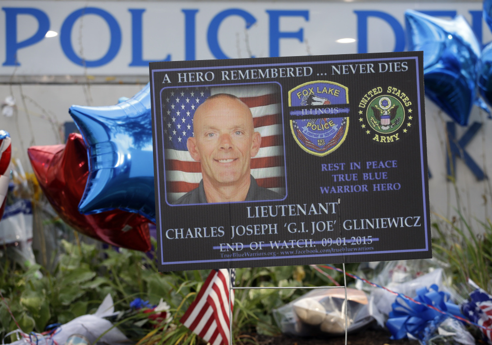 A memorial is in place at the Fox Lake Police Department in Fox Lake, Ill., on Sept. 2, when it was believed that Lt. Charles Joseph Gliniewicz was slain in the line of duty.