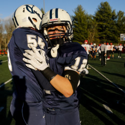 Byron Bergeron and Henry Venden celebrate the Yarmouth Clippers's win against Wells to secure the Class C South championship. Ben McCanna/Staff Photographer