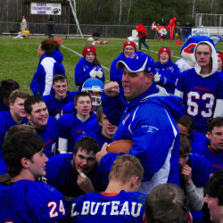 Stacen Doucette, Oak Hill coach, talks to his players after the Raiders beat Lisbon in the Class C South championship.