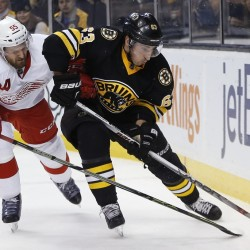 Detroit's Niklas Kronwall, left, defends against Brad Marchand during Boston's 3-1 win Saturday night at the TD Garden. It was just the second home win of the season for the Bruins in eighth games.