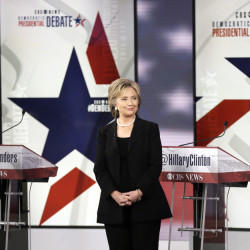 Democratic presidential candidates Bernie Sanders, left, Hillary Rodham Clinton and Martin O'Malley take the stage Saturday at the Democratic presidential primary debate in Iowa.