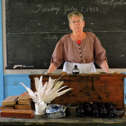 A historical interpreter from the Washburn-Norlands Living History Center in Livermore will portray a schoolmarm during a one-room schoolhouse re-enactment Wednesday at the South Berwick Senior Center on Norton Street.
