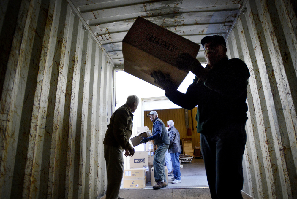 Workers load a truck that will carry 40,000 pounds of medical supplies to Boston for shipping to Turkey on Monday.