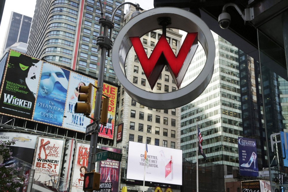 FILE  - In this Wednesday, July 31, 2013, file photo, the logo for the W Hotel, owned by Starwood Hotels & Resorts Worldwide, is seen in New York's Times Square. Marriott International announced Monday, Nov. 16, 2015, it is buying rival hotel chain Starwood for $12.2 billion in a deal that will secure its position as the world's largest hotelier. (AP Photo/Mark Lennihan, File)