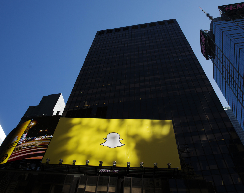 A billboard displays the logo of Snapchat above Times Square in New York earlier this year.